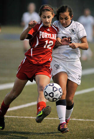 Portland's AnnaRose Zampano and Immaculate's Natalia Diaz compete for the loose ball during their Class S state championship game at Municipal Stadium in Waterbury on Friday, Nov. 23, 2012. Immaculate won, 5-0. Photo: Jason Rearick / The News-Times