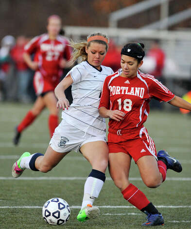 Portland's Jacqueline Otake challenges Immaculate's Lindsay Jossick for the ball during their Class S state championship game at Municipal Stadium in Waterbury on Friday, Nov. 23, 2012. Immaculate won, 5-0. Photo: Jason Rearick / The News-Times