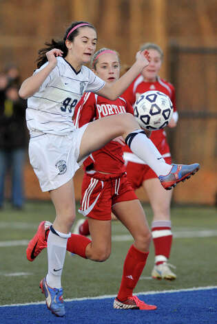 Immaculate's Hailey Davis attempts to volley the ball into the back of Portland's net during their Class S state championship game at Municipal Stadium in Waterbury on Friday, Nov. 23, 2012. Immaculate won, 5-0. Photo: Jason Rearick / The News-Times