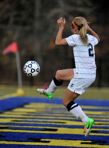 Immaculate's Lindsay Jossick volleys the ball into the back of Portland's net during their Class S state championship game at Municipal Stadium in Waterbury on Friday, Nov. 23, 2012. Immaculate won, 5-0. Photo: Jason Rearick / The News-Times