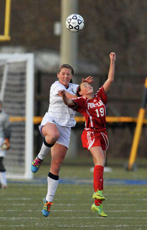 Immaculate's Sierra Stein and Portland's Madison Bond compete for the loose ball during their Class S state championship game at Municipal Stadium in Waterbury on Friday, Nov. 23, 2012. Immaculate won, 5-0. Photo: Jason Rearick / The News-Times