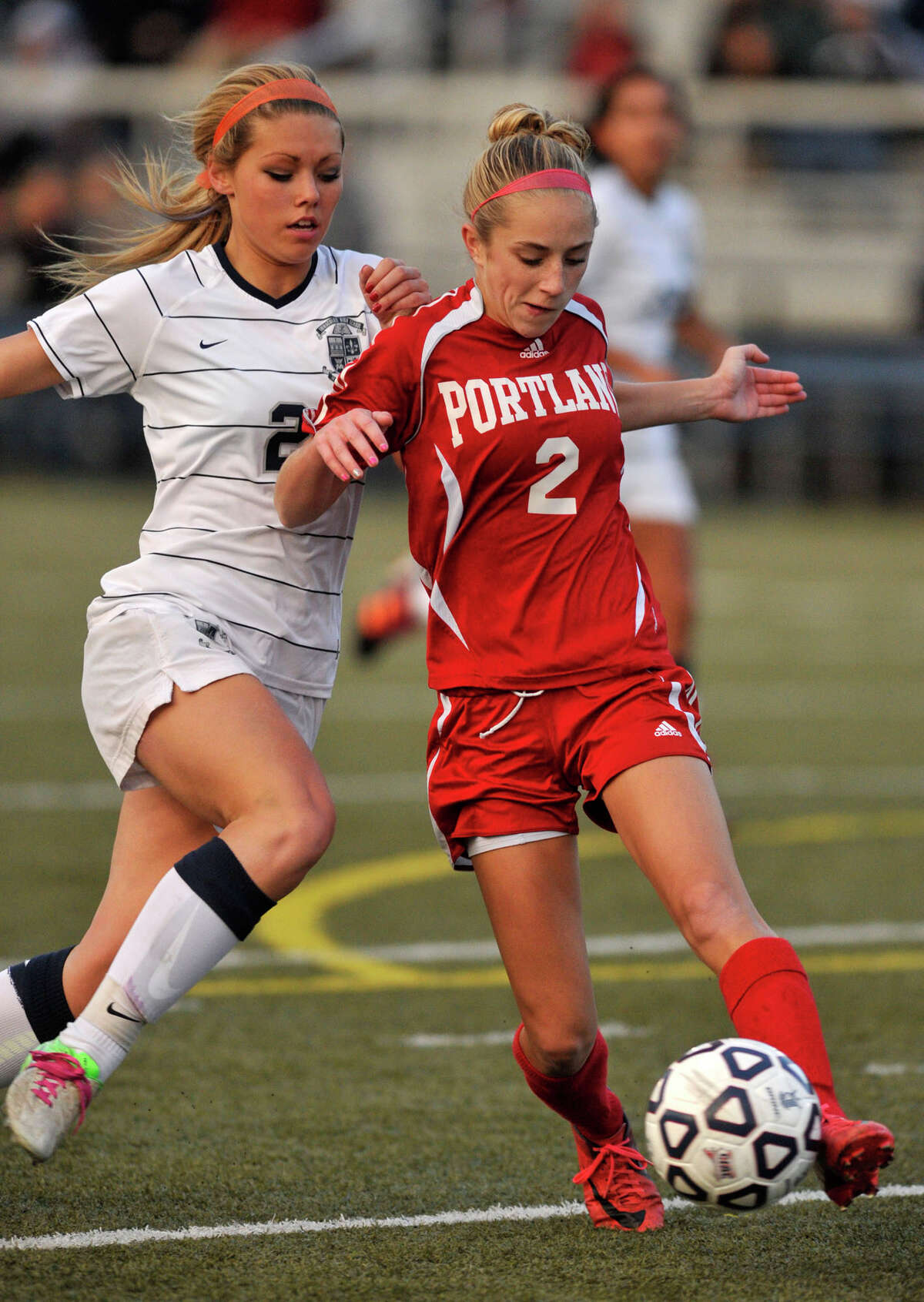 Immaculate's Lindsay Jossick challenges Portland's Emma Ruppert for the ball during their Class S state championship game at Municipal Stadium in Waterbury on Friday, Nov. 23, 2012. Immaculate won, 5-0.