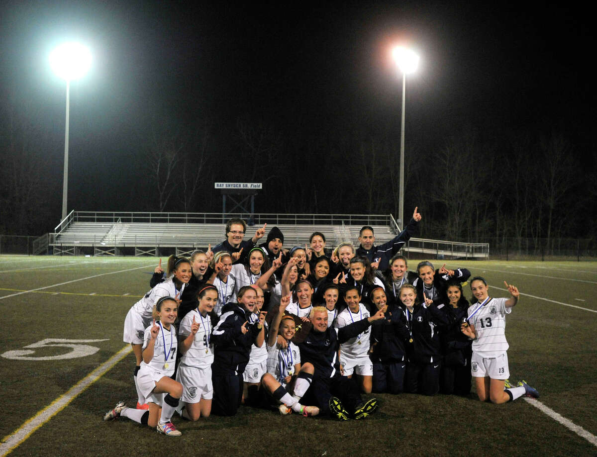 The Immaculate High School girls soccer team celebrates its Class S state championship win over Portland at Municipal Stadium in Waterbury on Friday, Nov. 23, 2012. Immaculate won, 5-0.