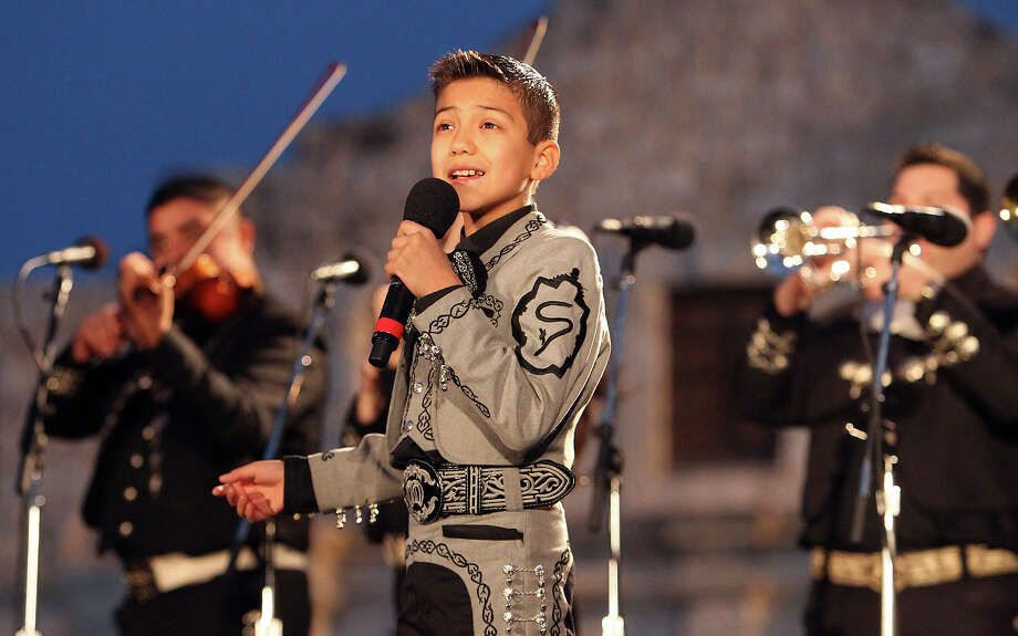 "Sebastian de la Cruz, 10, of ""America's Got Talent"" fame sings for the audience at Alamo Plaza for the 28th Annual H-E-B Tree Lighting Ceremony on Friday, Nov. 23, 2012. The 55-foot tall fir tree was lit with 10,000 LED lights and with 450 ornaments. The event kicked off the holiday season followed by the 30th Annual Ford Holiday River Parade & Lighting Ceremony along the San Antonio River. Photo: Kin Man Hui, San Antonio Express-News / ©2012 San Antonio Express-News"