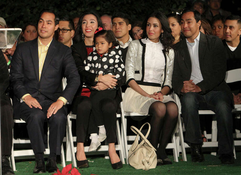 Mayor Julián Castro (from left), his wife Erica, their daughter Carina, Anna Flores and newly-elected U.S. Rep. Joaquín Castro attend the 28th Annual H-E-B Tree Lighting Ceremony on Friday, Nov. 23, 2012. The 55-foot tall fir tree was lit with 10,000 LED lights and with 450 ornaments. The event kicked off the holiday season followed by the 30th Annual Ford Holiday River Parade & Lighting Ceremony along the San Antonio River. Photo: Kin Man Hui, San Antonio Express-News / ©2012 San Antonio Express-News