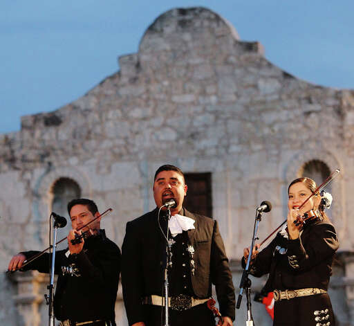 Mariachi band, Los Charros de Oro, entertains the crowd with music at the 28th Annual H-E-B Tree Lighting Ceremony on Friday, Nov. 23, 2012. The 55-foot tall fir tree was lit with 10,000 LED lights and with 450 ornaments. The event kicked off the holiday season followed by the 30th Annual Ford Holiday River Parade  & Lighting Ceremony along the San Antonio River. Photo: Kin Man Hui, San Antonio Express-News / ©2012 San Antonio Express-News