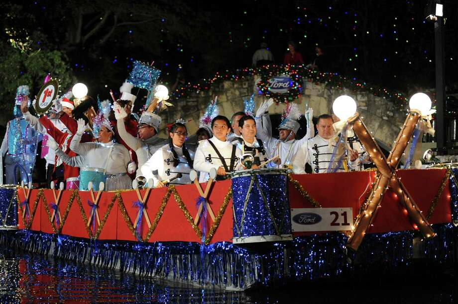 Members of the San Antonio Street Dance and Drum float display their first-place ribbon, at left, during the 30th annual Ford Holiday River Parade  & Lighting Ceremony on the River Walk in downtown San Antonio on Friday, Nov. 23, 2012. Photo: Billy Calzada, San Antonio Express-News / SAN ANTONIO EXPRESS-NEWS