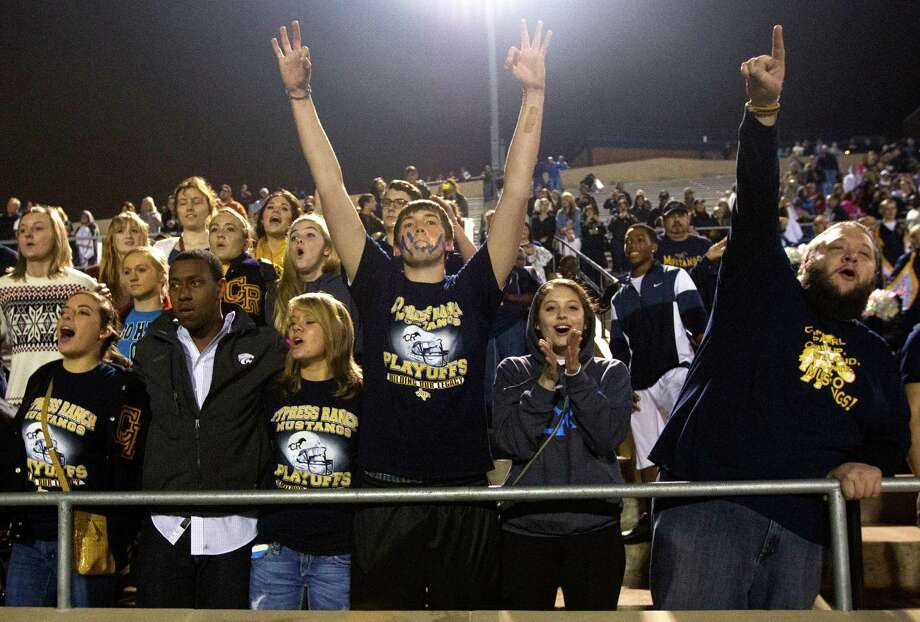 Cypress Ranch fans celebrate after defeating Memorial 17 - 7 in the Class 5A Division II area round playoffs at Tully Stadium on Friday, Nov. 23, 2012, in Houston. Photo: J. Patric Schneider, For The Chronicle / © 2012 Houston Chronicle
