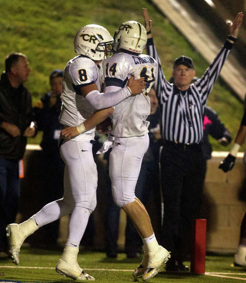 Cypress Ranch quarterback Cole Martin (14) is congratulated by teammate Hunter Kliafas (8) after scoring a touchdown in the third quarter during the Class 5A Division II area round playoffs against Memorial at Tully Stadium on Friday, Nov. 23, 2012, in Houston. Photo: J. Patric Schneider, For The Chronicle / © 2012 Houston Chronicle