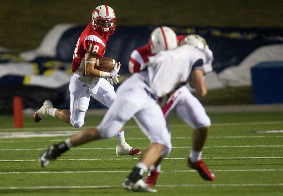 Memorial wide receiver Ryan Baumgartner (18) looks for running room against Cypress Ranch in the second quarter during the Class 5A Division II area round playoffs at Tully Stadium on Friday, Nov. 23, 2012, in Houston. Photo: J. Patric Schneider, For The Chronicle / © 2012 Houston Chronicle