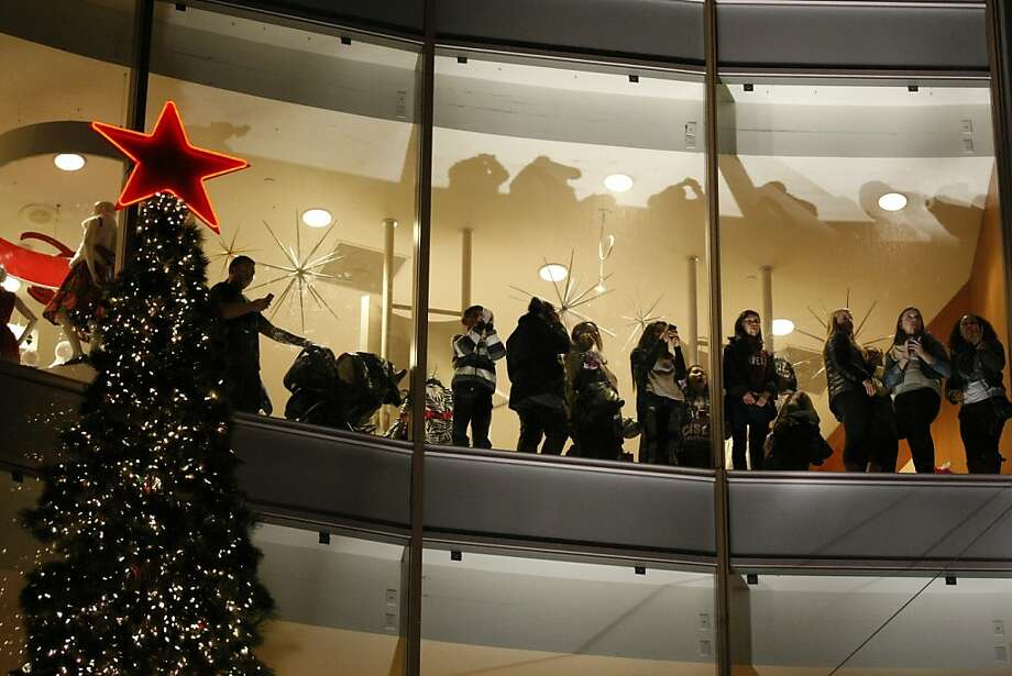 Crowds inside Macy's watched Macy's 23rd Annual Great Tree Lighting Ceremony Friday night at Union Square in San Francisco, Calif. Photo: Rashad Sisemore, The Chronicle