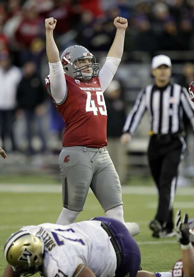 Andrew Furney reacts to a field goal that came before his game-winner. Photo: Ted S. Warren, Associated Press
