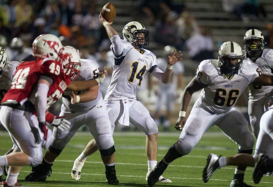 Cypress Ranch quarterback Cole Martin (14) throws a pass in the second quarter against Memorial during the Class 5A Division II area round playoffs at Tully Stadium on Friday, Nov. 23, 2012, in Houston. Photo: J. Patric Schneider, For The Chronicle / © 2012 Houston Chronicle