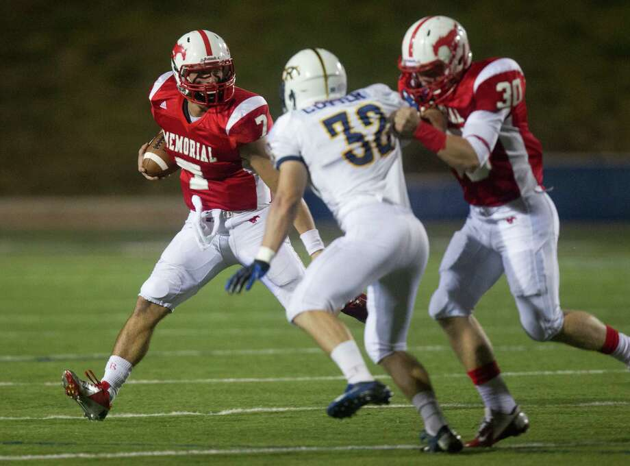 Memorial quarterback Tyler McCloskey (7) looks for running room in the  second quarter against Cypress Ranch during the Class 5A Division II area round playoffs at Tully Stadium on Friday, Nov. 23, 2012, in Houston. Photo: J. Patric Schneider, For The Chronicle / © 2012 Houston Chronicle