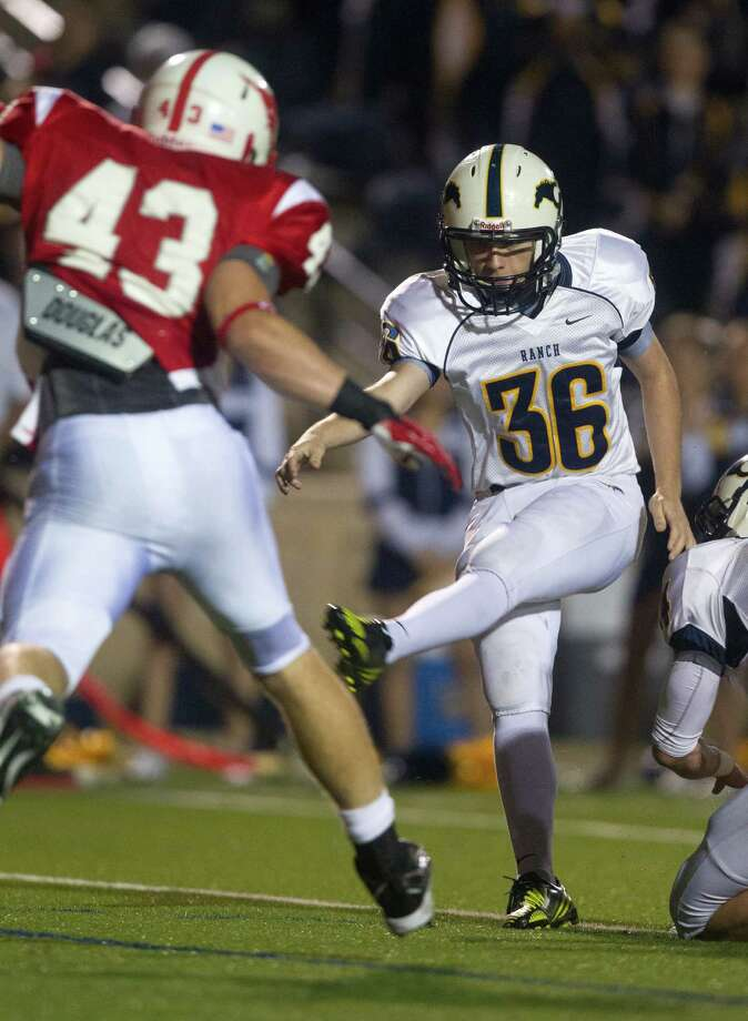Cypress Ranch place kicker Ian Marshall (36) kicks a field goal in the first quarter against Memorial during the Class 5A Division II area round playoffs at Tully Stadium on Friday, Nov. 23, 2012, in Houston. Photo: J. Patric Schneider, For The Chronicle / © 2012 Houston Chronicle