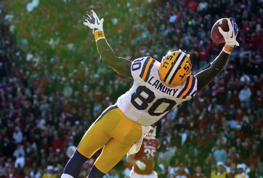 Jarvis Landry's leaping one-handed touchdown catch from quarterback Zach Mettenberger in the second quarter helped LSU hold off Arkansas on Friday. Photo: David Quinn, FRE / FR74919 AP