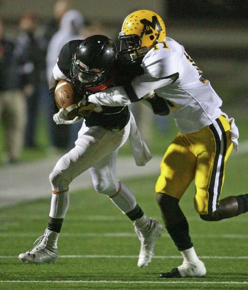 Texas City wide receiver Armanti Foreman (left) is tackled by Fort Bend Marshall defensive back Kend