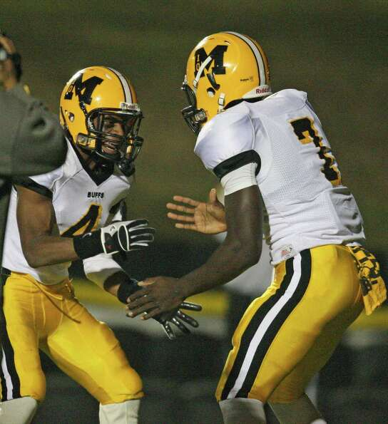 Fort Bend Marshall quarterback JW Ketchum (7) celebrates his 35-yard touchdown run with Ashton Ford