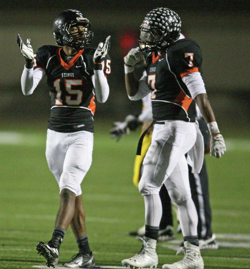 Texas City defensive back Chris Gray )15) celebrates a tackle for a loss during the first half of a 4A Division II high school area round playoff game against Fort Bend Marshall, Friday, November 23, 2012 at Galena Park ISD Stadium in Houston, TX. Photo: Eric Christian Smith, For The Chronicle