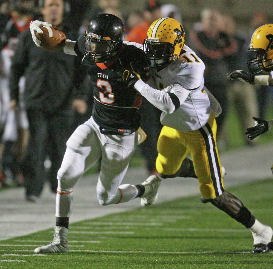 Texas City wide receiver Armanti Foreman (left) is tackled by Fort Bend Marshall defensive back Kendall Sheffield during the first half of a 4A Division II high school area round playoff game, Friday, November 23, 2012 at Galena Park ISD Stadium in Houston, TX. Photo: Eric Christian Smith, For The Chronicle