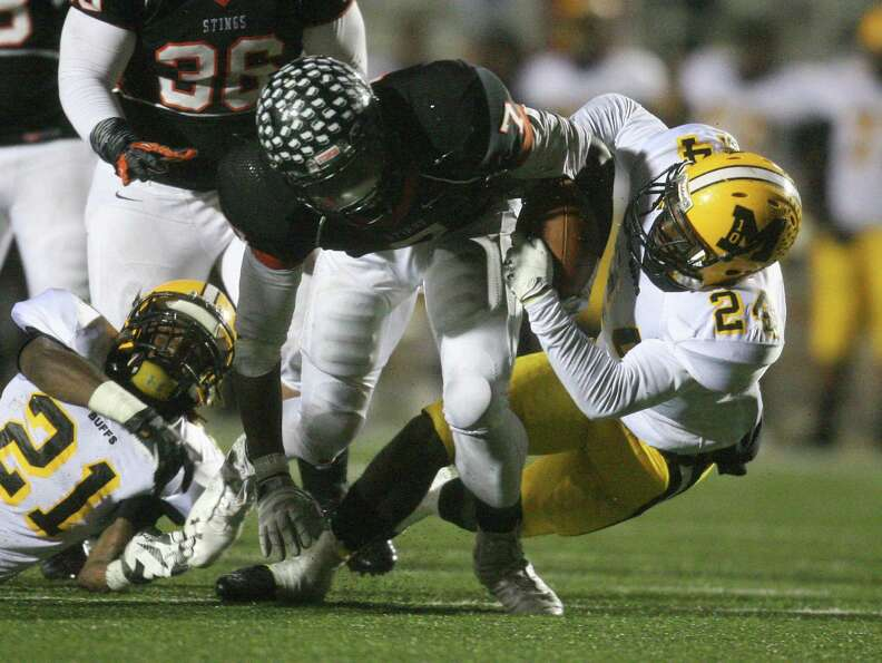 Texas City running back D'onta Foreman (7) is tackled by Fort Bend Marshall defensive back Jordan Ho