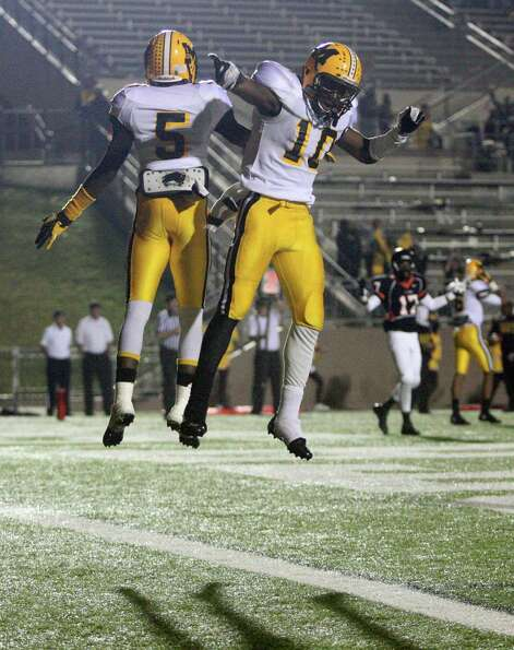 Fort Bend Marshall's Jeremiah Baines (5) celebrates his 4-yard touchdown reception with teammate Eli