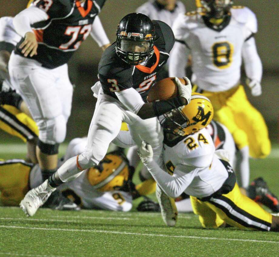 Texas City wide receiver Armanti Foreman (3) is tackled by Fort Bend Marshall defensive back Jordan Horace during the first half of a 4A Division II high school area round playoff game, Friday, November 23, 2012 at Galena Park ISD Stadium in Houston, TX. Photo: Eric Christian Smith, For The Chronicle
