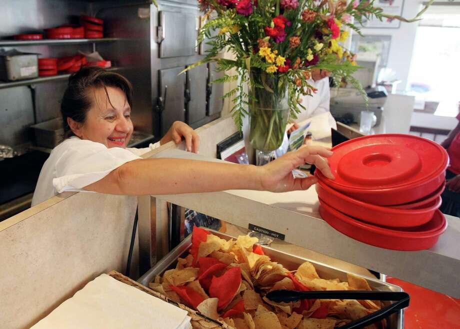 Helen Velesiotis, owner of San Antonio's nationally recognized Taco Taco Cafe, plans to work harder as she becomes a franchisor. Photo: Helen L. Montoya, Staff / ©SAN ANTONIO EXPRESS-NEWS