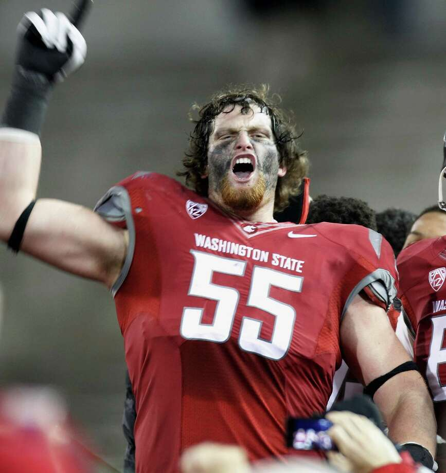 Wade Jacobson #55 of the Washington State Cougars celebrates on the field after the Cougars win the Apple Cup 31-28 during overtime against the Washington Huskies. Photo: William Mancebo, Getty Images / 2012 Getty Images