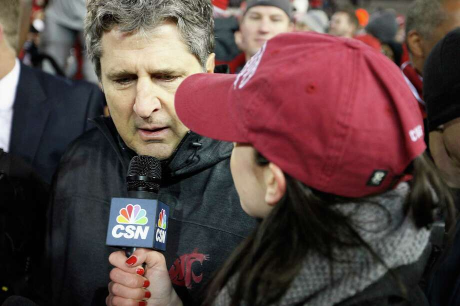 Head coach Mike Leach of the Washington State Cougars is interviewed on the field after beating the Washington Huskies 31-28 during overtime in the Apple Cup. Photo: William Mancebo, Getty Images / 2012 Getty Images
