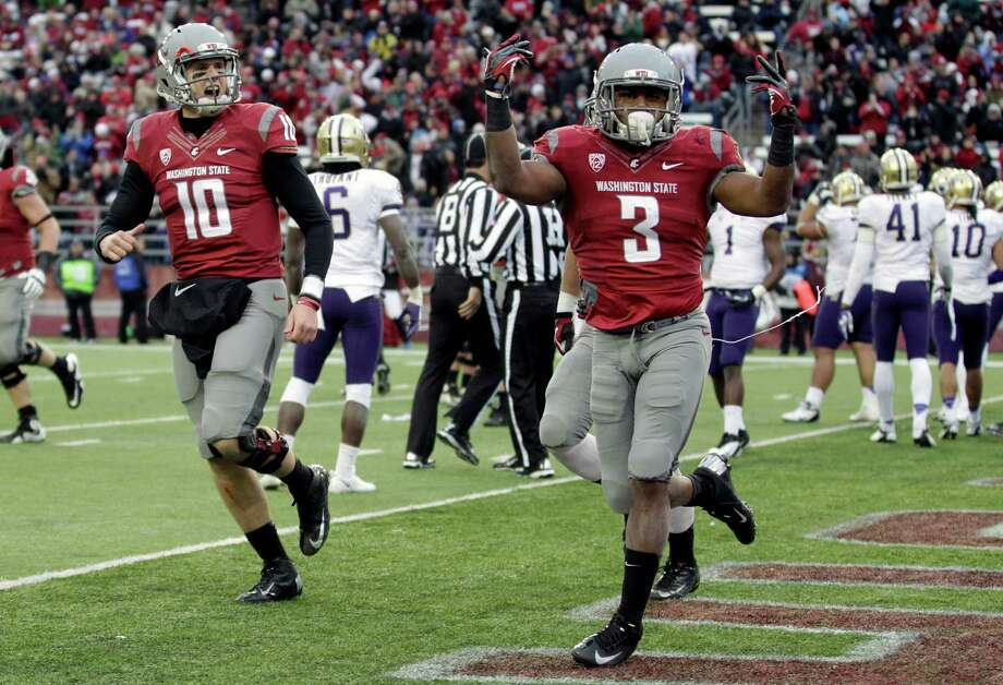 Washington State's Carl Winston (3) reacts with quarterback Jeff Tuel (10) after scoring his third touchdown. Photo: AP
