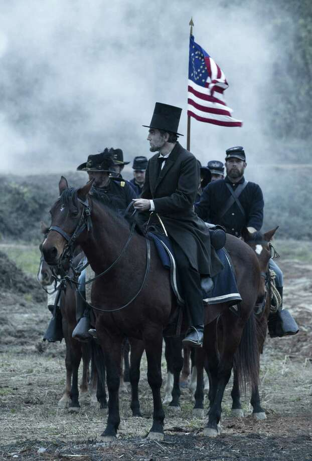 "Daniel Day-Lewis as President Abraham Lincoln surveys the aftermath of battle.  Congress should be required to watch ""Lincoln."" Photo: 20th Century Fox / DreamWorks, Twentieth Century Fo"