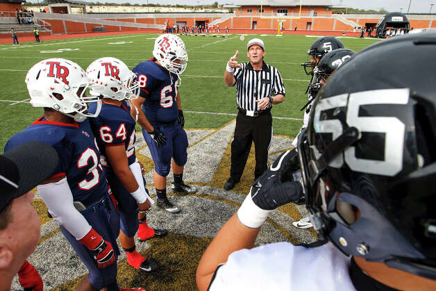 The referee flips the coin prior to the Class 5A Division II second round playoff game between Roosevelt (left) and Steele at Heroes Stadium on Nov. 23, 2012.  Steele won the game 45-0. MARVIN PFEIFFER/ mpfeiffer@express-news.net Photo: MARVIN PFEIFFER, Express-News / Express-News 2012