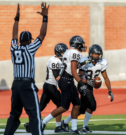 The referee signals touchdown as Steele's Robert Woods (from left) and Richard Marrero congratulate Keshawn Brown on his 52 yard touchdown during the fourth quarter of their Class 5A Division II second round playoff game at Heroes Stadium on Nov. 23, 2012. Steele won the game 45-0.  MARVIN PFEIFFER/ mpfeiffer@express-news.net Photo: MARVIN PFEIFFER, Express-News / Express-News 2012
