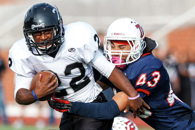 Steele running back Christian Edmondson can't escape a tackle by Roosevelt's Jonathan Leos during the third quarter of their Class 5A Division II second round playoff game at Heroes Stadium on Nov. 23, 2012.  Steele won the game 45-0. MARVIN PFEIFFER/ mpfeiffer@express-news.net Photo: MARVIN PFEIFFER, Express-News / Express-News 2012
