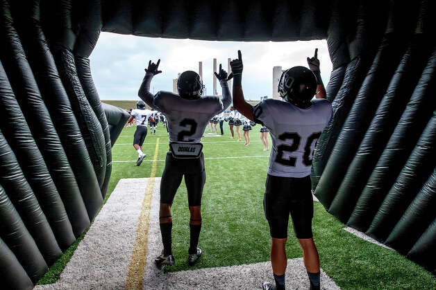 Steele's Jordan Sterns (left) and Matthew Mayle point their fingers to the sky inside the helmet as the Knights take the field prior to their Class 5A Division II second round playoff game with Roosevelt at Heroes Stadium on Nov. 23, 2012.  MARVIN PFEIFFER/ mpfeiffer@express-news.net Photo: MARVIN PFEIFFER, Express-News / Express-News 2012