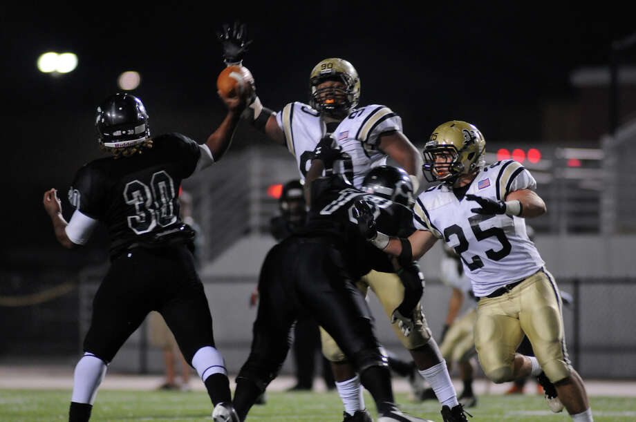 Nederland defensive lineman DeShawn Washington looks to knock down a pass against Pflugerville Connally in a Class 4A Division I area around playoff game at Woodforest Bank Stadium on Friday, Nov. 23, 2012. (Jerry Baker/Special to The Enterprise)