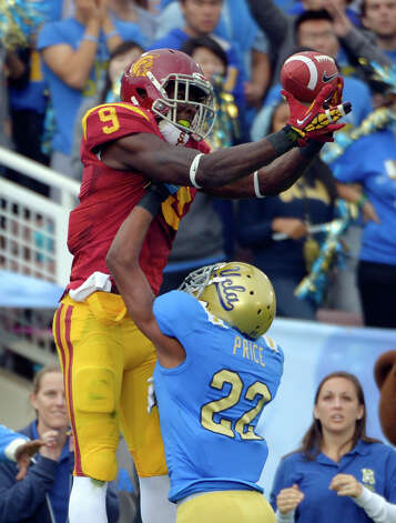 Southern California wide receiver Marqise Lee, left, can't hold on to a pass in the end zone as UCLA cornerback Sheldon Price defends during the first half of their NCAA college football game, Saturday, Nov. 17, 2012, in Pasadena, Calif. Price was called for pass interference on the play. (AP Photo/Mark J. Terrill) Photo: Mark J. Terrill