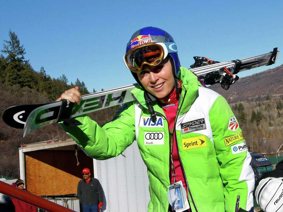 Lindsey Vonn, of the United States, carries her skis during practice for the women's World Cup ski race in Aspen, Colo. on Friday, Nov. 23, 2012. (AP Photo/Alessandro Trovati) Photo: Alessandro Trovati