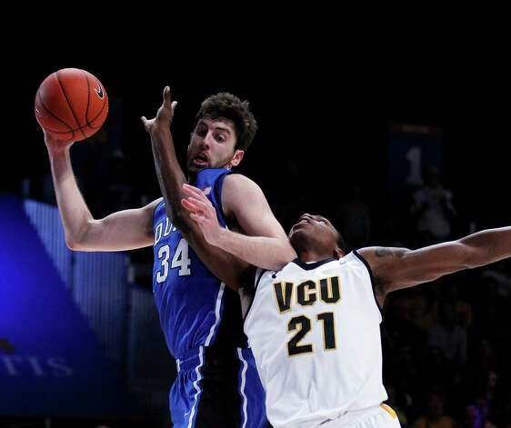 Duke forward Ryan Kelly (34) and Virginia Commonwealth guard Treveon Graham (21) fight for a rebound in the first half of an NCAA college basketball  game at the Battle 4 Atlantis tournament on Friday, Nov. 23, 2012, in Paradise Island, Bahamas. (AP Photo/John Bazemore) Photo: John Bazemore