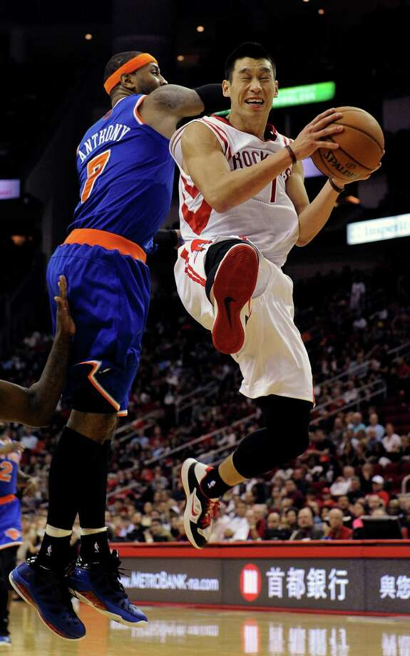 Houston Rockets' Jeremy Lin, right, goes to the basket as New York Knicks' Carmelo Anthony, left, tries to stop him in the second half of an NBA basketball game, Friday, Nov. 23, 2012, in Houston. (AP Photo/Pat Sullivan) Photo: Pat Sullivan