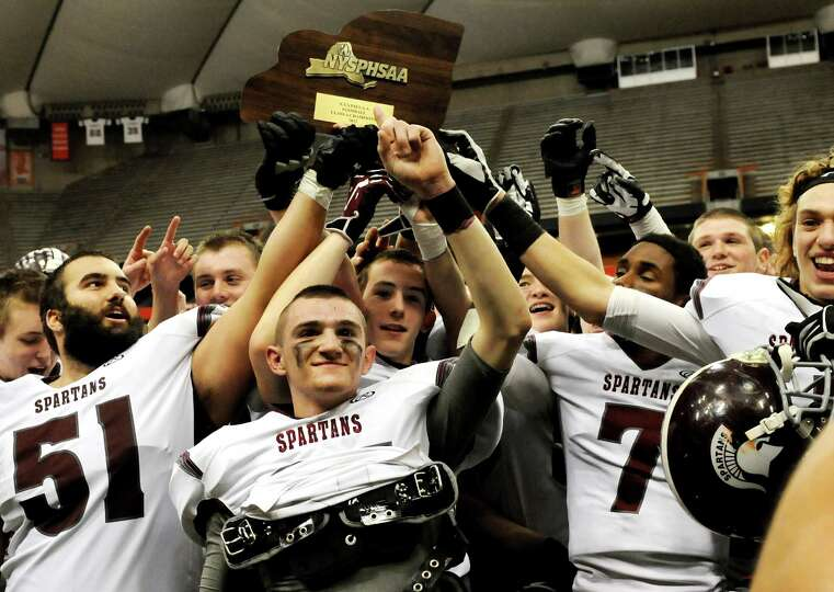 Burnt Hills' players show off their state title when they win 40-14 over Sweet Home in their Class A