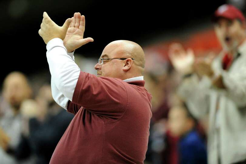 Burnt Hills' fan Mike Venditti cheers for his team during the Class A football state final against S