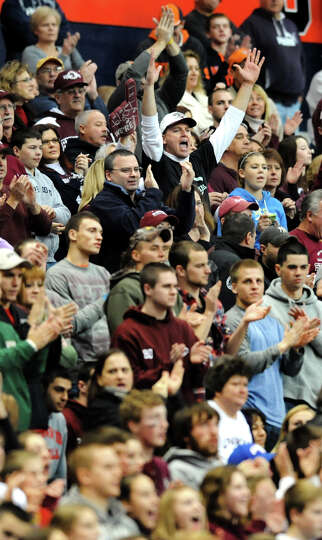 Burnt Hills' fans cheer on their team during the Class A football state final against Sweet Home on
