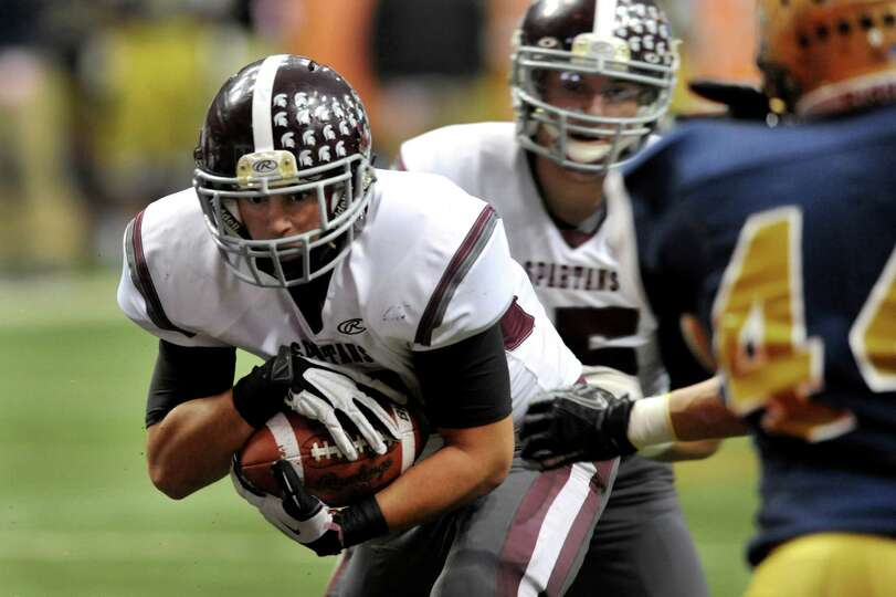 Burnt Hills' Daniel Maynard (11), left, heads for the endzone during their Class A football state fi