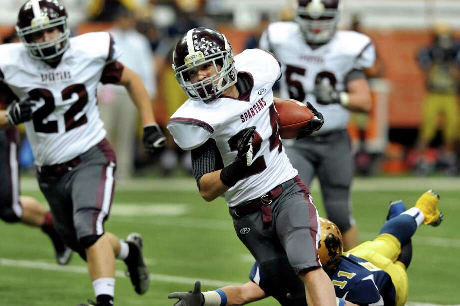 Burnt Hills' Joshua Quesada (24), center, dodges a tackle during their Class A football state final against Sweet Home on Friday, Nov. 23, 2012, at the Carrier Dome in Syracuse, N.Y. (Cindy Schultz / Times Union) Photo: Cindy Schultz /  00020203A
