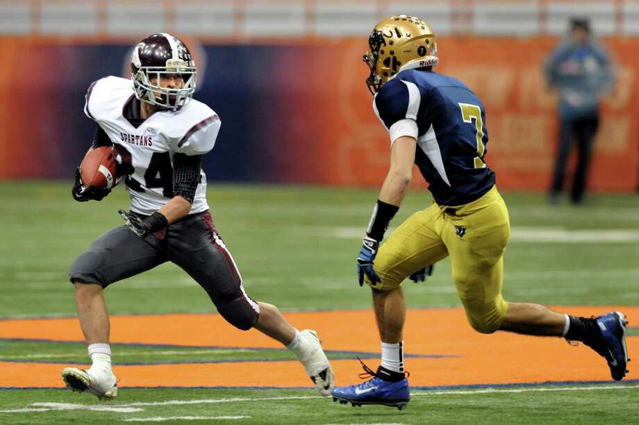 Burnt Hills' Joshua Quesada (24), left, skirts around Sweet Home's Carter Mann (7) during their Class A football state final against Sweet Home on Friday, Nov. 23, 2012, at the Carrier Dome in Syracuse, N.Y. (Cindy Schultz / Times Union) Photo: Cindy Schultz /  00020203A