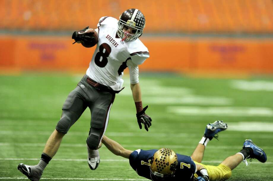 Burnt Hills' Eric Dillon (8), left, dodges a tackle from Sweet Home's Carter Mann (7) during their Class A football state final on Friday, Nov. 23, 2012 at the Carrier Dome in Syracuse, N.Y. (Cindy Schultz / Times Union) Photo: Cindy Schultz /  00020203A