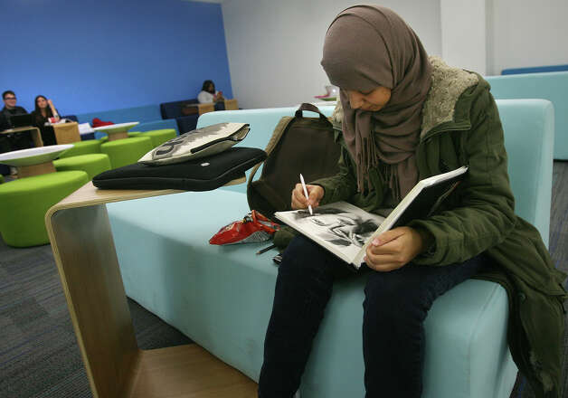 Student Arib Alajmi of Trumbull works on a portrait in her sketchbook in the new student lounge area in the Charles Dana science building at the University of Bridgeport on Tuesday, November 20, 2012. Photo: Brian A. Pounds / Connecticut Post