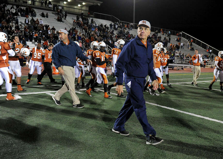 Madison head coach Jim Streety walks onto the field after his Mavericks defeated the East Central Hornets during a Class 5A Division I second round playoff game at Comalander Stadium in San Antonio, Friday, November 23, 2012.